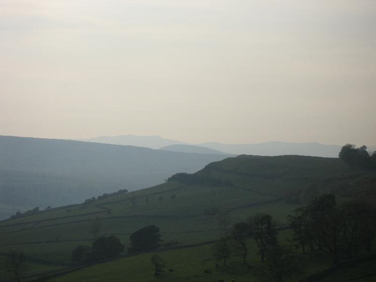 Looking back to the north end of Knipe Scar with the outline of Blencathra in the far distance