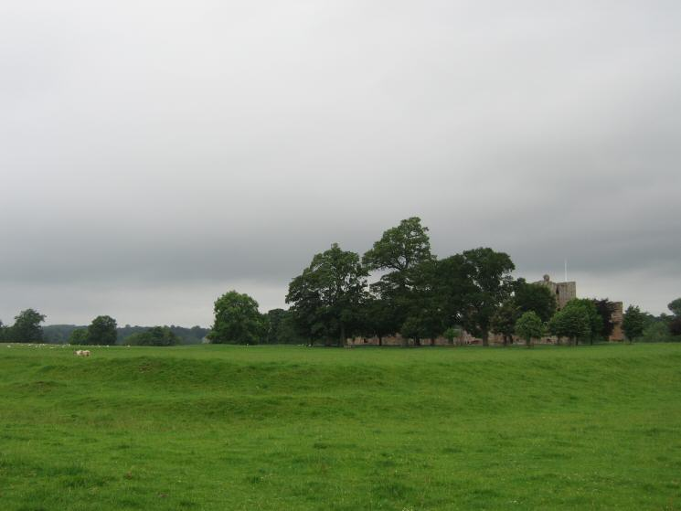 Corner of the earth bank, all that remains of BROCAVUM Roman Fort with Brougham Castle behind
