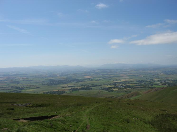Looking across the Vale of Eden to the Lakeland Fells (Helvellyn, The Dodds and Blencathra)