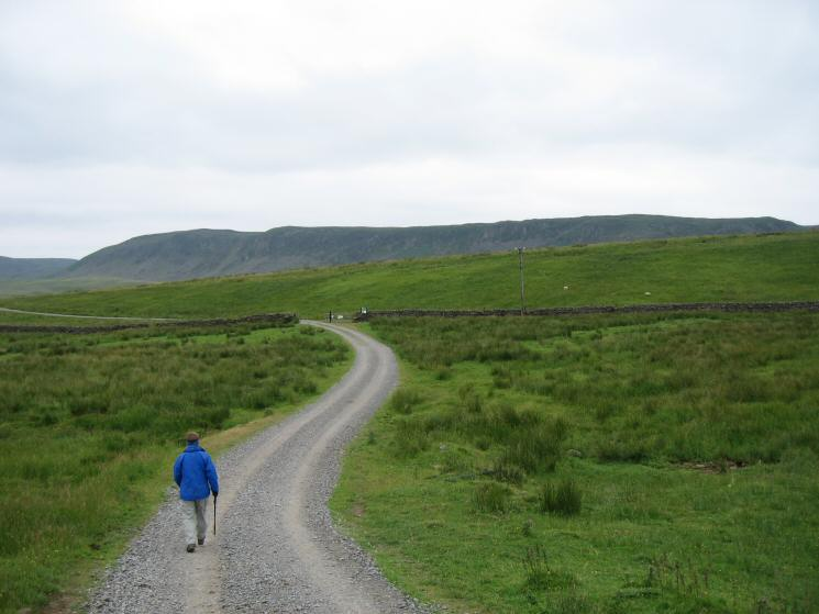 Heading along the track to Widdy Bank Farm with Cronkley Scar in front