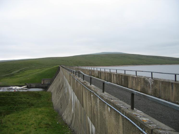 Cow Green Dam. The fell in the far distance is Meldon Hill