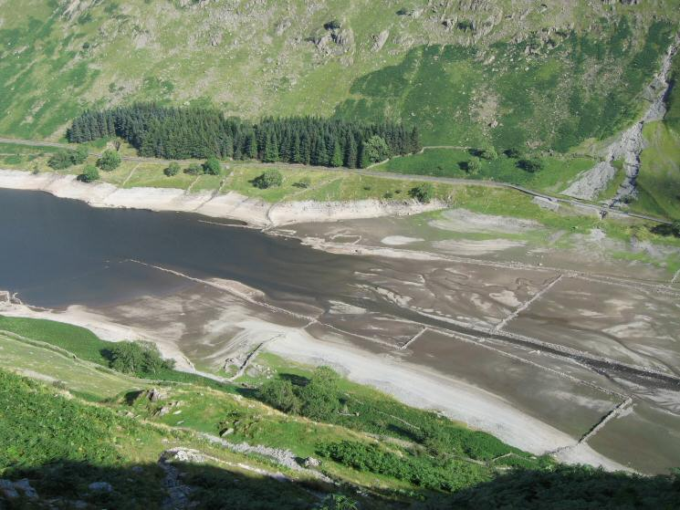 Looking down on the head of Haweswater with the old walls out of the water