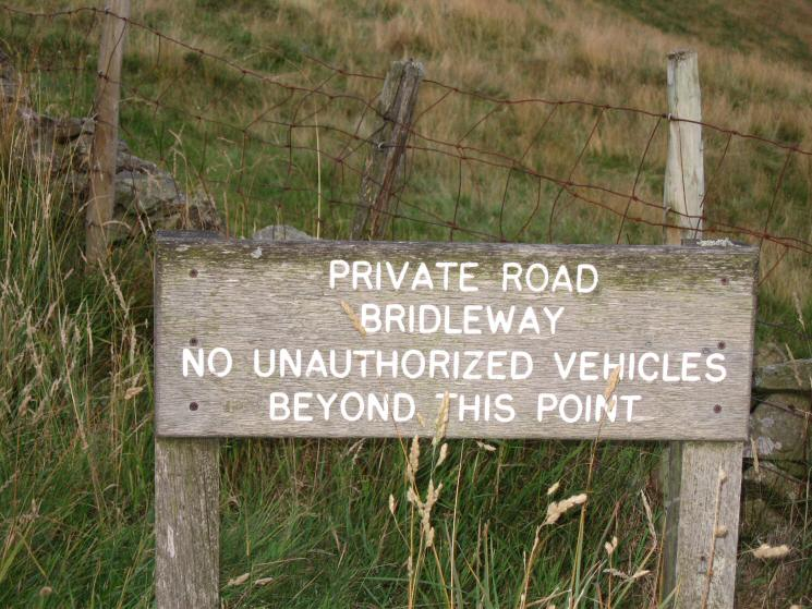 Road sign at the end of the public road / start of the private  road and bridleway to Great Dun Fell