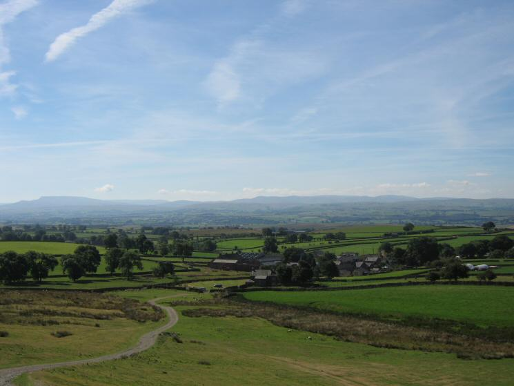 Looking back to Murton with Wild Boar Fell (left) and the Howgill Fells (right) in the distance