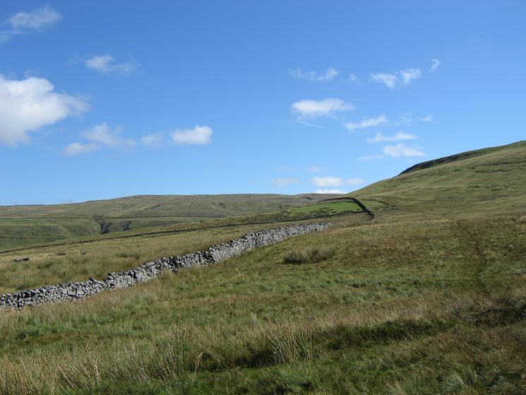 Our route follows the wall round the side of Tailbidge Hill, Nine Standards Rigg in the distance