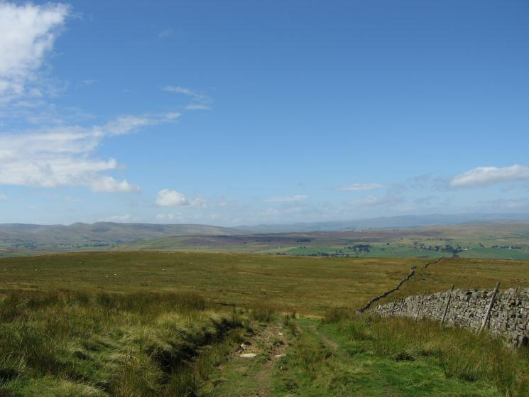 Looking back down our route by the wall with the Howgills on the left skyline and the Lakeland Fells in the distance on the right