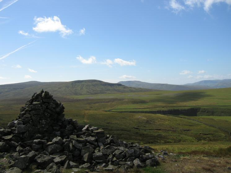 High Seat and High Pike Hill with Wild Boar Fell behind and the Howgills in the distance on the far right