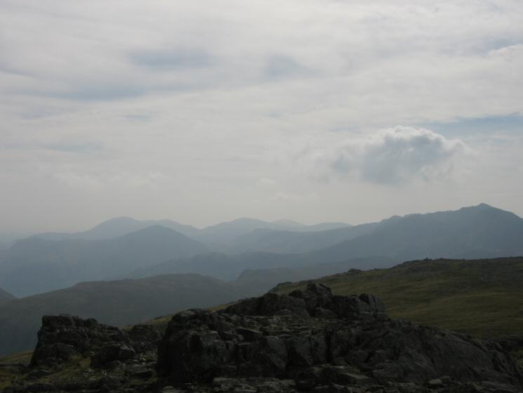 Pike O' Blisco on the left and Bowfell on the right with the Coniston Fells in the distance from Glaramara's summt