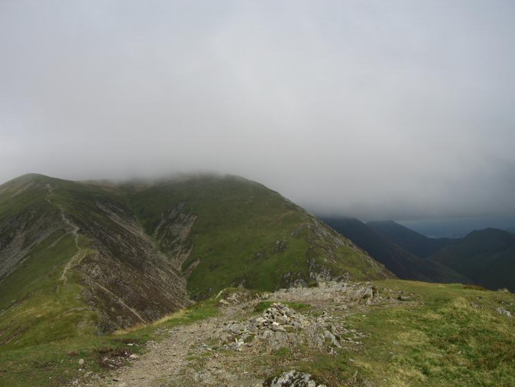 Looking back to the path up Whiteless Edge to Thirdgill Head Man from Whiteless Pike's summit