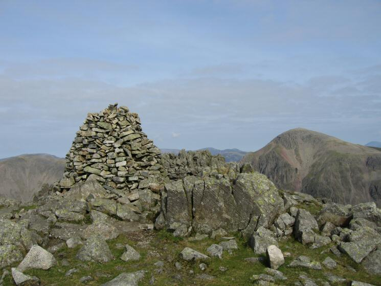 Lingmell's summit cairn with Great Gable on the right