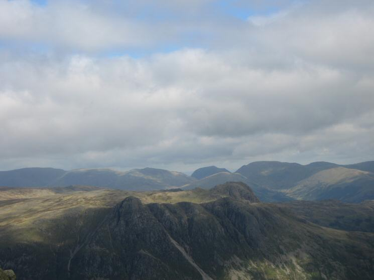 Looking over the Langdale Pikes to the south end of the Helvellyn ridge, Saint Sunday Crag and Fairfield from Crinkle Crags