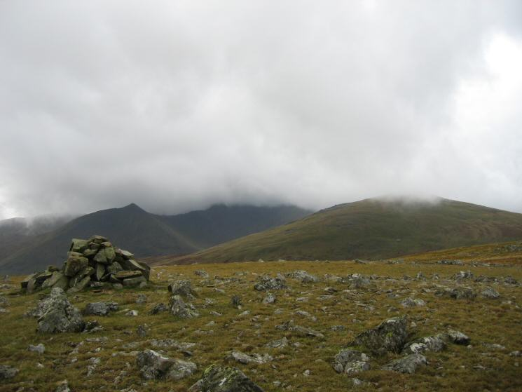 The pointed top of Catstycam, Helvellyn in cloud and Raise from White Stones (Green Side)