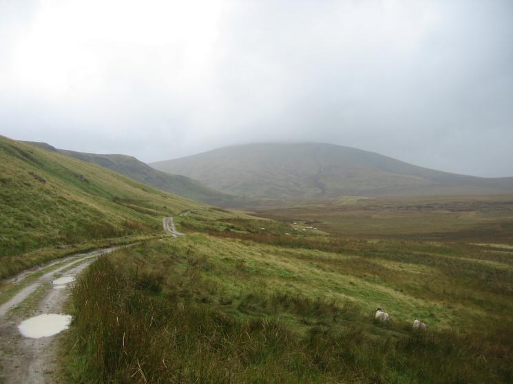 Looking back along the Old Coach Road with Clough Head's top now in cloud