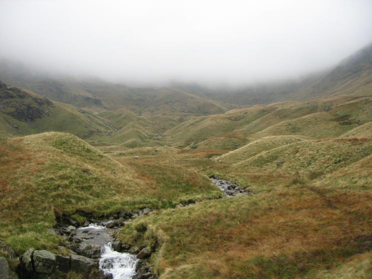 Sleet Cove from above the waterfalls. Deepdale Hause is in the cloud right of centre