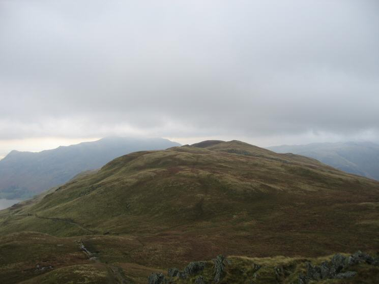 Birks with Place Fell behind on the left from the path off Saint Sunday Crag