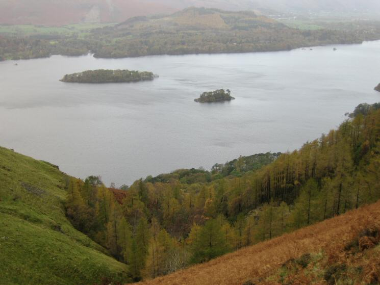 St Herbert's Island on the left and Rampsholme Island on the right with the wooded Swinside on the far side of Derwent Water