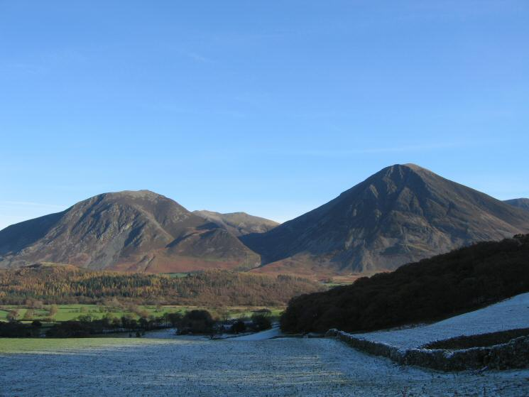 Whiteside and Grasmoor with Hopegill Head between seen across frostly fields