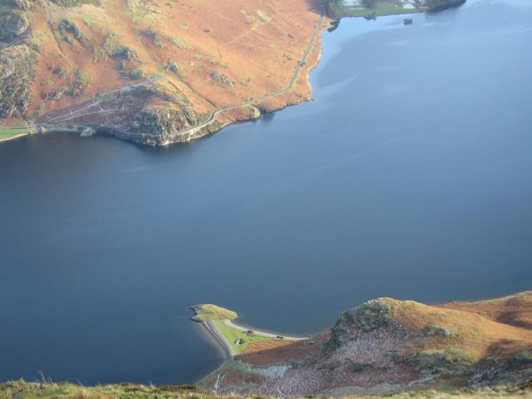 Looking down on Low Ling Crag sticking out into Crummock Water with Hause Point on the far side