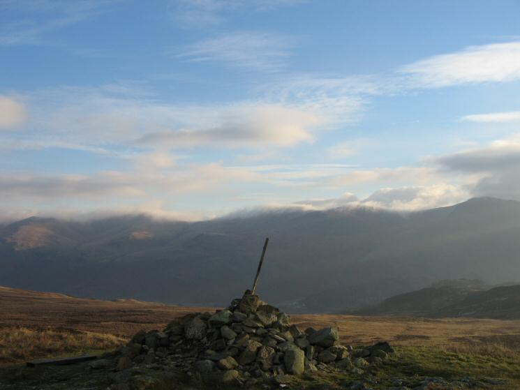 The Helvellyn ridge with cloud hugging its top from High Tove's summit