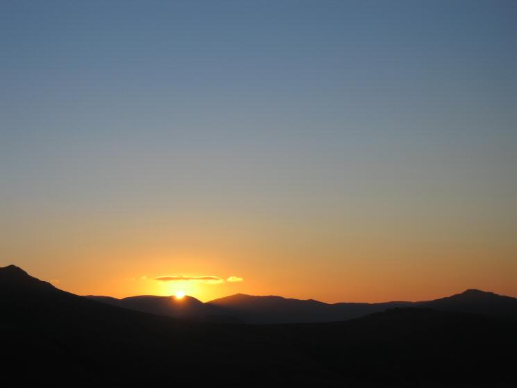 Sunrise over the Coniston Fells from high up on Yewbarrow