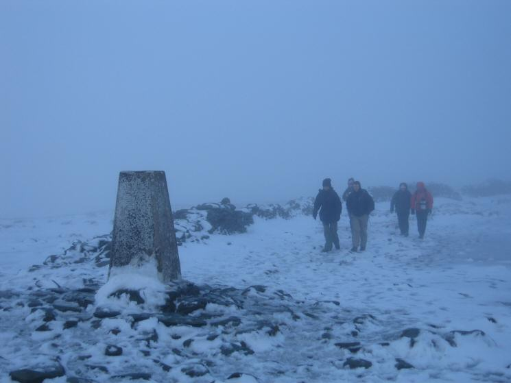 Walkers approaching High Street's summit trig point