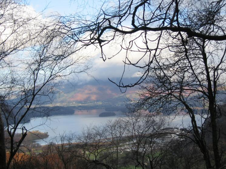 Derwent Water through the trees on the ascent of Grange Fell