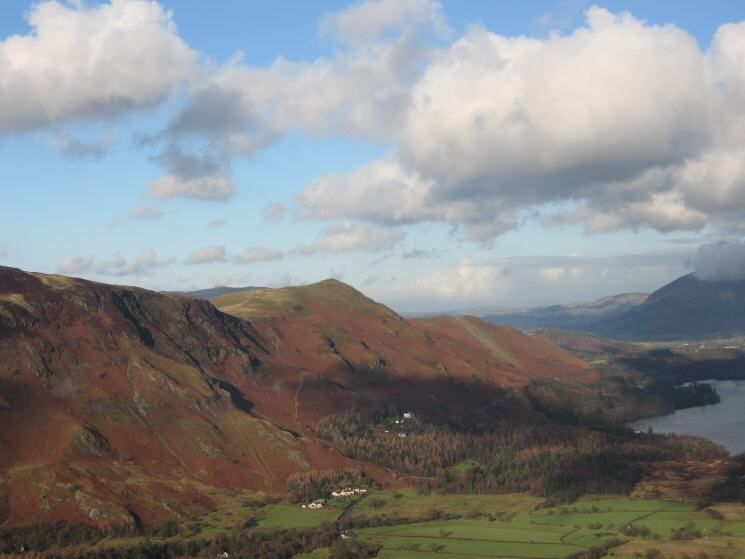 The pink houses of Manesty with Catbells behind