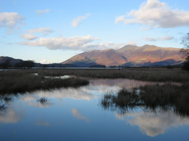 Looking across a flooded Cannon Dub to a cloud free Skiddaw