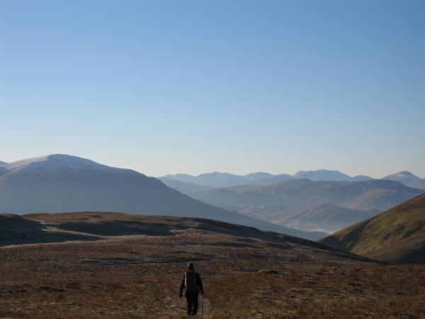 Heading south along Souther fell's broad top. Clough Head on the left, Crinkle Crags to Great Gable on the skyline