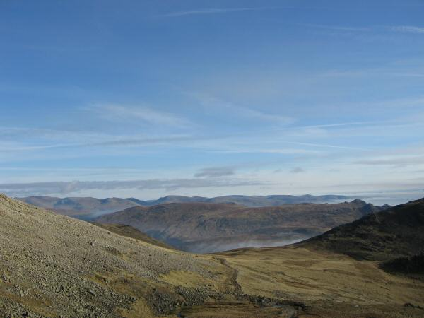 Looking back to Esk Hause with High Raise behind and the Fairfield fells on the skyline