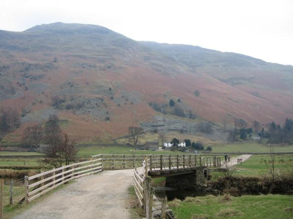 The track to Side Farm with the slopes of Place Fell behind