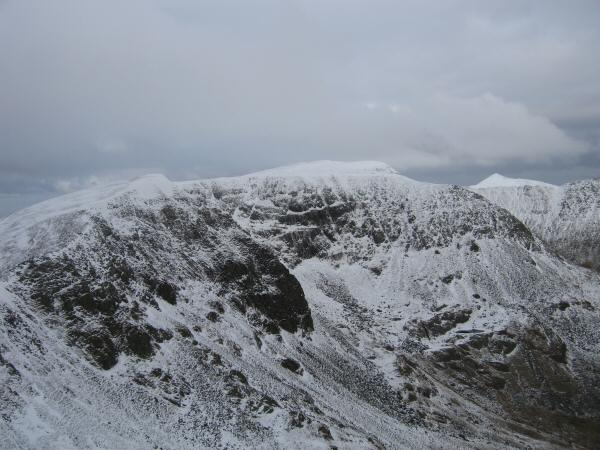 High Crag, Nethermost Pike, Helvellyn and the pointed top of Catstycam from Dollywaggon Pike's summit