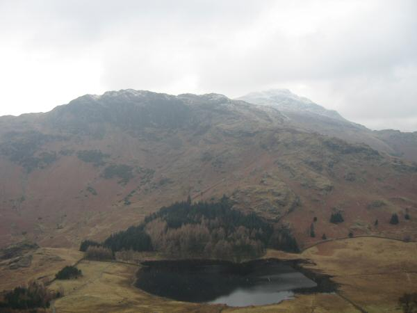 Looking over Blea Tarn to Blake Rigg with some snow on Pike o' Blisco behind