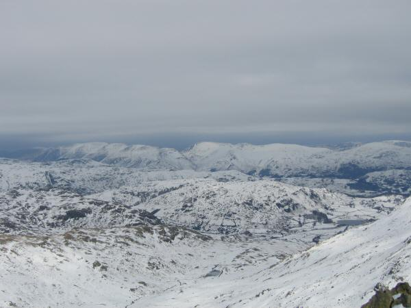 The view north east to the Helvellyn ridge and Fairfield fells from Swirl How's summit