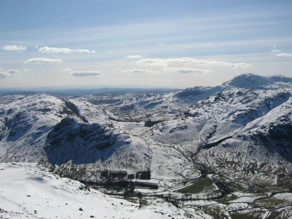Looking across Great Langdale to Blea Tarn with Side Pike to its left  and Blake Rigg with Wetherlam behind on the right