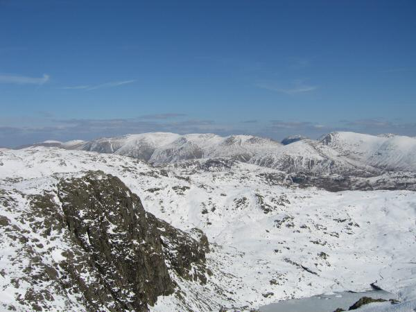 Pavey Ark with the Helvellyn fells and Fairfield beyond from Harrison Stickle's summit