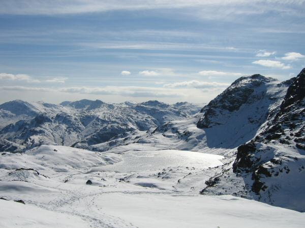Stickle Tarn and Harrision Stickle with the Coniston Fells and Pike o' Blisco beyond