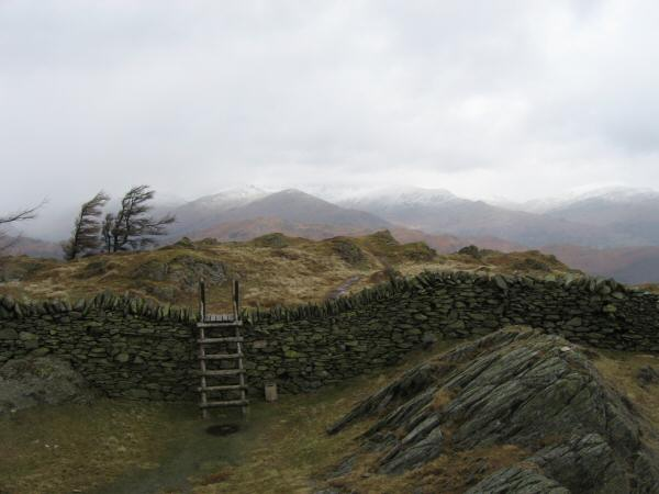 The view north from Black Crag's summit with snow on the high fells