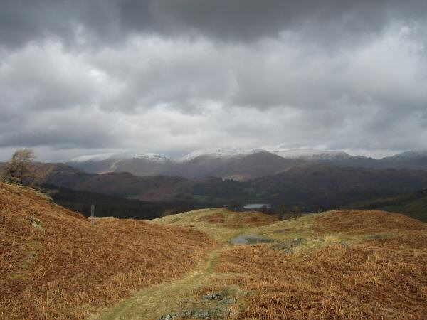 Snow on the Helvellyn and Fairfield fells from the northeast ridge of Holme Fell
