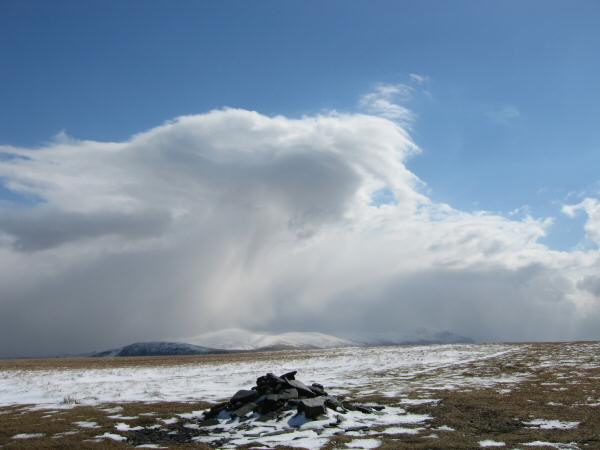 Clouds over the Helvellyn fells from Lonscale Fell's summit