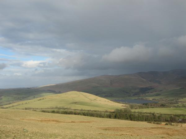 Latrigg, catching the sun, and Over Water with Longlands Fell behind from the slopes of Binsey