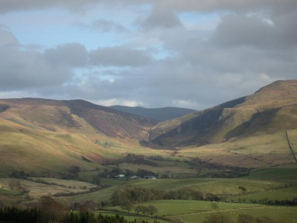 The valley of Dash Beck with Whitewater Dash at its head and Blencathra behind (the dark fell in the distance)