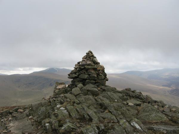 Carrock Fell's summit, with Blencathra to the left of the cairn
