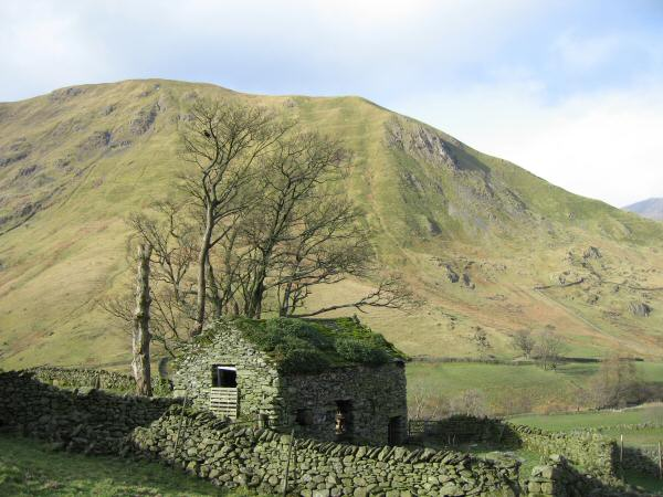 An old barn just outside the village of Hartsop with Hartsop Dodd behind