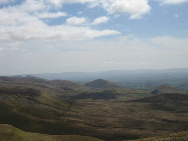 The pointed Dufton Pike to the south with Knock Pike on the far right