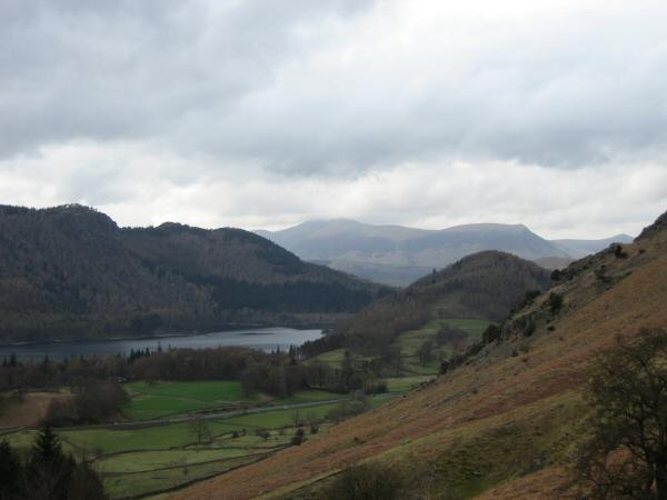 Raven Crag above Thirlmere, the Skiddaw  fells in the distance and the wooded conical Great How