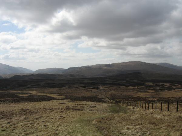 The way south from High Seat. The fell on the skyline (right of centre) is Ullscarf with High Raise on the far right