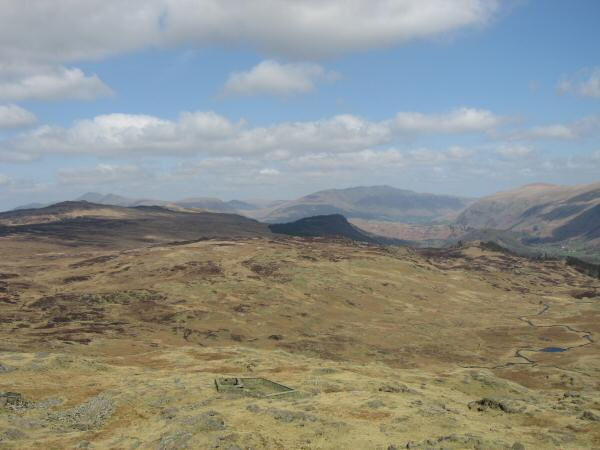 High Seat, Armboth Fell, the wooded Raven Crag and Skiddaw, Blencathra and Clough Head in the distance from Bell Crags' summit