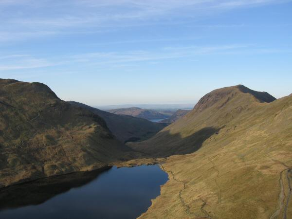 Grisedale Tarn at the head of Grisedale with Dollywaggon Pike on the left and Saint Sunday Crag on the right