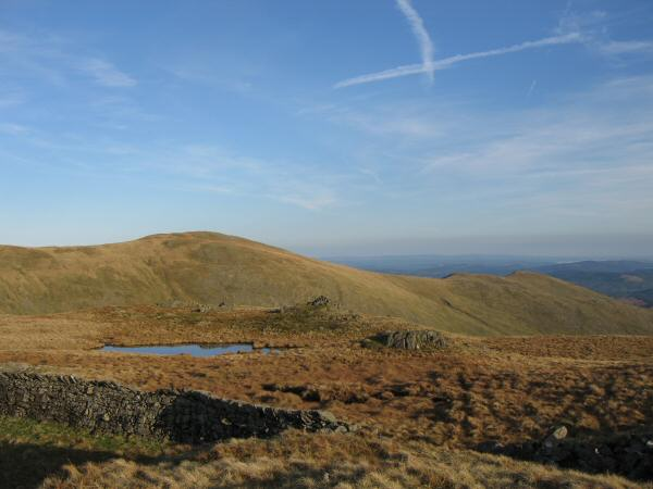 Seat Sandal's summit tarn with Great Rigg and the two tops of Heron Pike behind